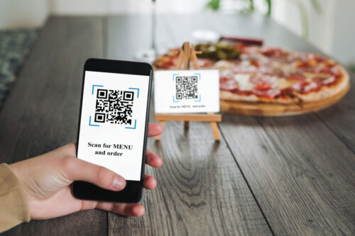 Women's,Hands,Using,The,Phone,To,Scan,The,Qr,Code